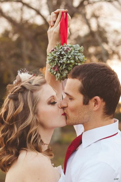 Bride and Groom Mistletoe Kiss