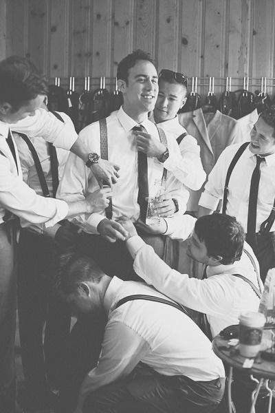 guys helping groom get ready